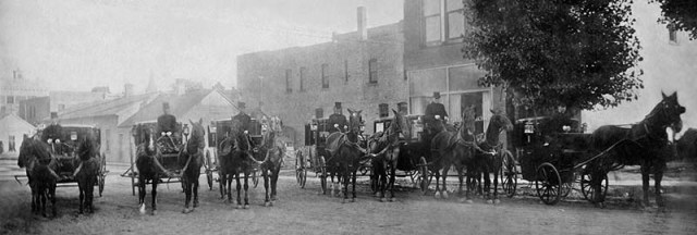 H.Noble & Son's Fleet of Horse Drawn Hearses with Kerosene Lanterns Mitchell, SD 1886 - 800px